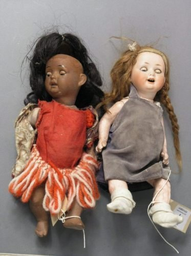4: A small bisque doll and a mulatto doll