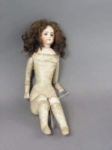 6: A French bisque doll, 20in. - head glue-repaired