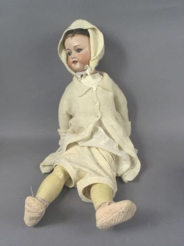 7: An Armand Marseille bisque doll, 28in.