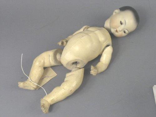 8: An Armand Marseille Oriental bisque doll, 15in.