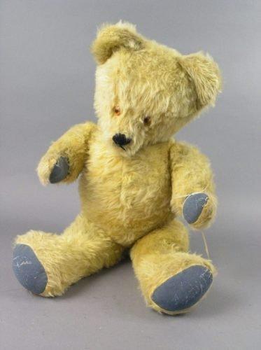10: A gold plush Teddy bear,