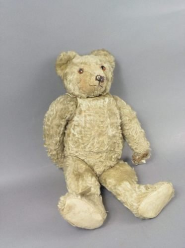 11: A blonde plush Teddy bear, 22in. - pads replaced; o