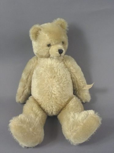12: A blonde plush Teddy bear, 26in.