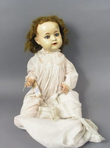 13: An Ernst Heubach painted bisque doll, 24in.