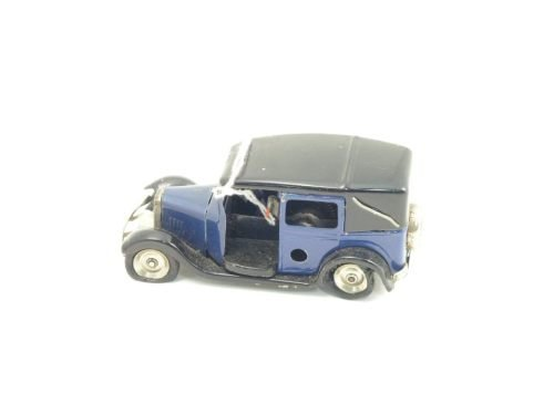 18: A Tri-ang Minic tinplate and clockwork taxi, 4in.