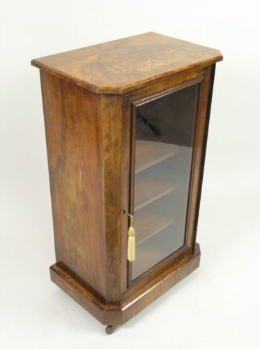 680: A Victorian inlaid walnut pier cabinet, 1ft 9ins