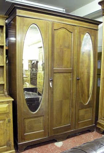 697: An Edwardian inlaid mahogany three-door wardrobe,