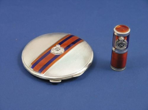 1140: A George VI silver compact case and lipstick,