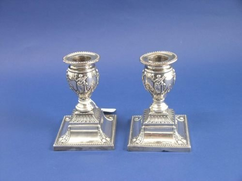 1150: A pair of late Victorian silver candlesticks, 4.5