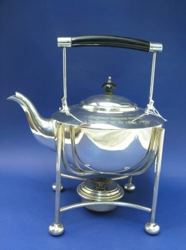 1154: An Edwardian silver plated kettle on stand, 11ins