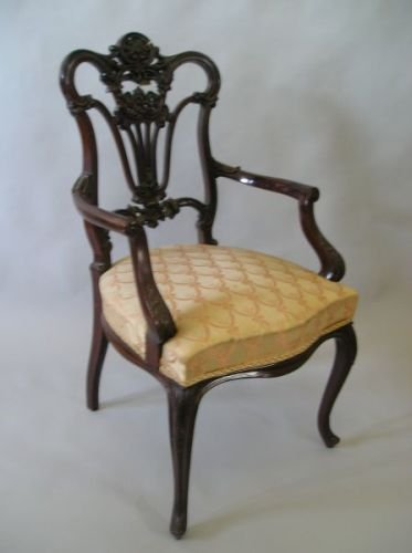 634E: A Victorian carved mahogany open armchair