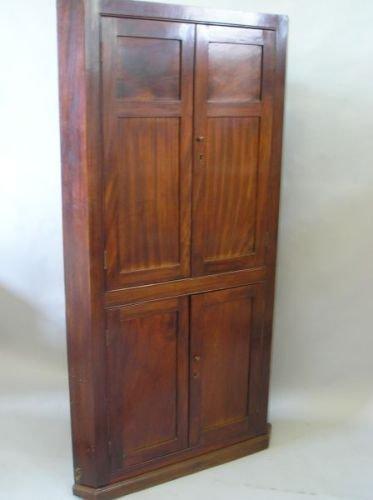 635E: A George III mahogany standing corner cupboard
