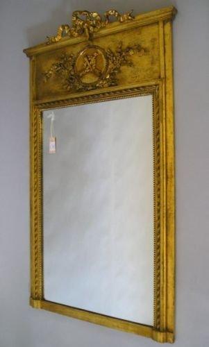 642E: A gilt-framed wall mirror