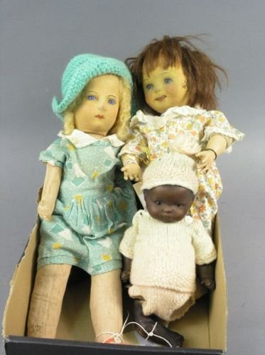 1: An Armand Marseille mulatto bisque doll and two clot