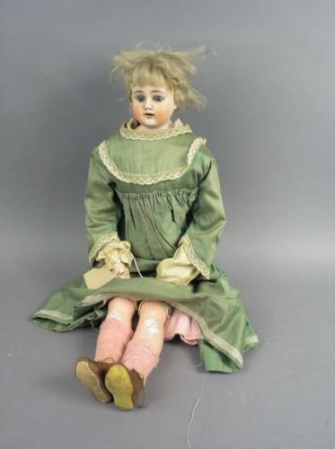 3: A German pale bisque doll, 24in.