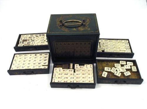 17: A green lacquered mahjong set, 7ins