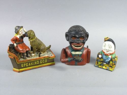 24: A cast iron money bank, 'Speaking Dog'  and two oth