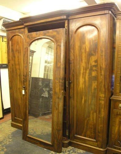 894: A Victorian mahogany breakfront wardrobe, 7ft heig