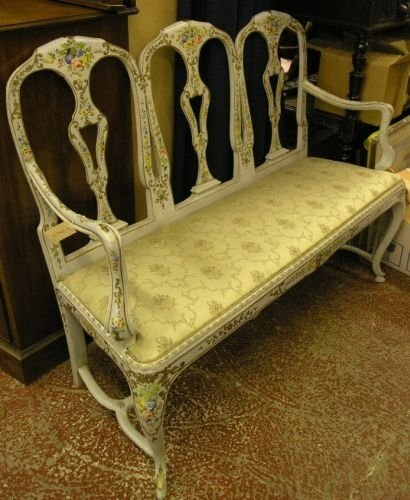 895: A 19th century painted and gilt triple chair back