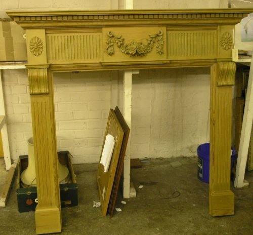 899: A carved pine fire surround, 4ft 1inch x 4ft 4ins