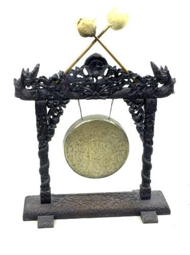 900: A Chinese brass gong on carved oak stand, 2ft 3.5i