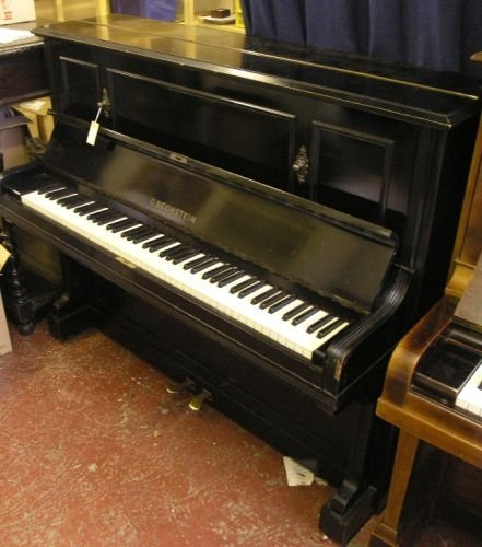 901: An ebonised Bechstein upright piano, height 3ft 11
