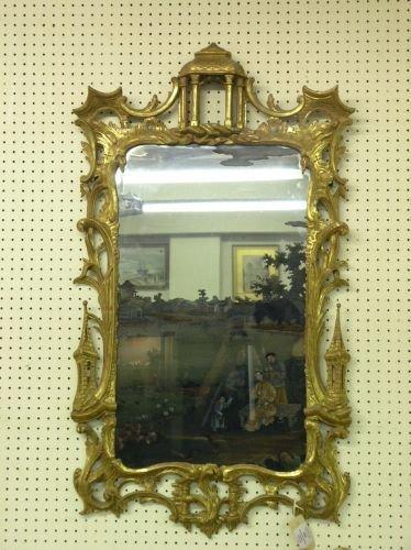 998: 18th century reverse painted glass mirror