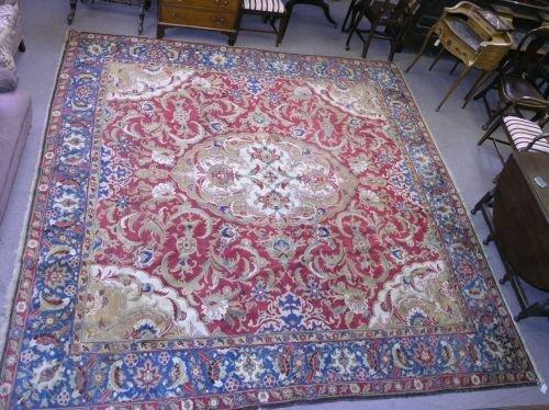 1079: A Persian carpet, 11ft 7ins x 12ft