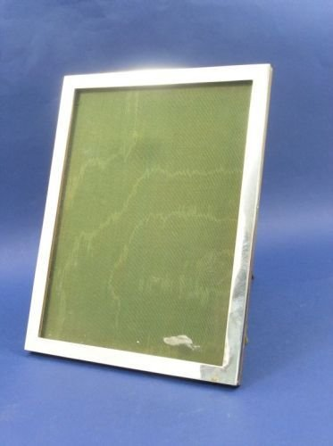 1299: A George V silver photograph frame, 9ins