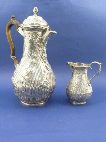 1300: A late Victorian silver coffee pot & cream jug
