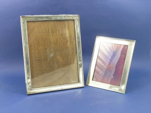 1305: An Edwardian silver photograph frame and another