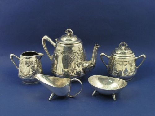 1309: A WMF silver plated 3-piece teaset and a cream ju