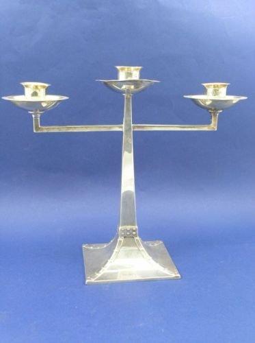 1311: An Arts & Crafts silver three light candelabrum,