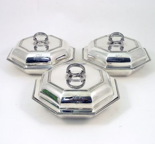 1315: A set of three George V silver entree dishes and