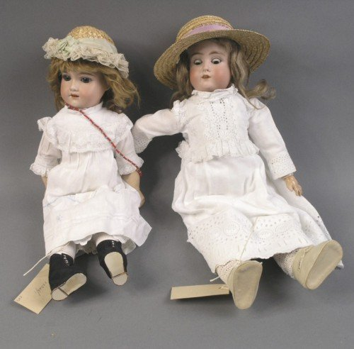 4: A Schoenau & Hoffmeister bisque doll and an Armand M