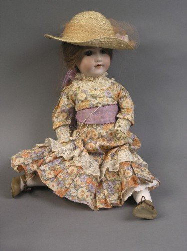 6: An Armand Marseille bisque doll, 18in.