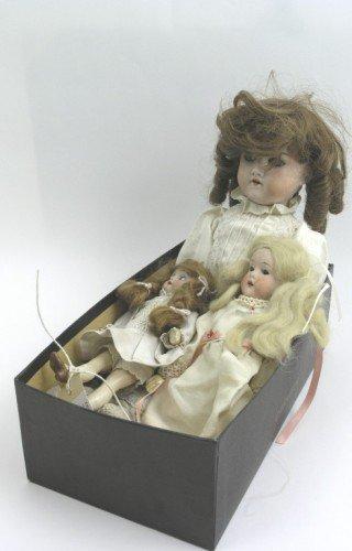 7: Three bisque dolls,