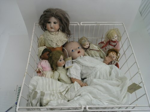 8: A German bisque doll, six other dolls and a doll's d