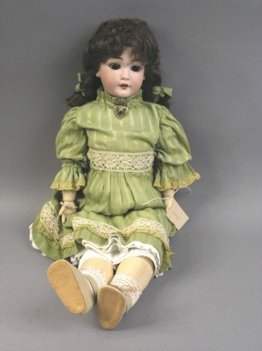 11: A Schoenau & Hoffmeister bisque doll, 24in.