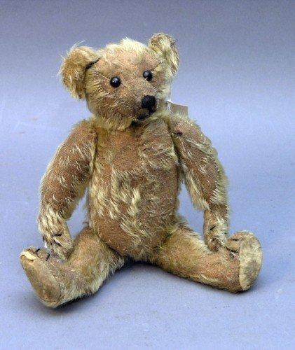 21: A small German Teddy bear, 12in. - plush worn