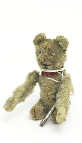 22: A Schuco clockwork tumbling Teddy bear, 4.75in.