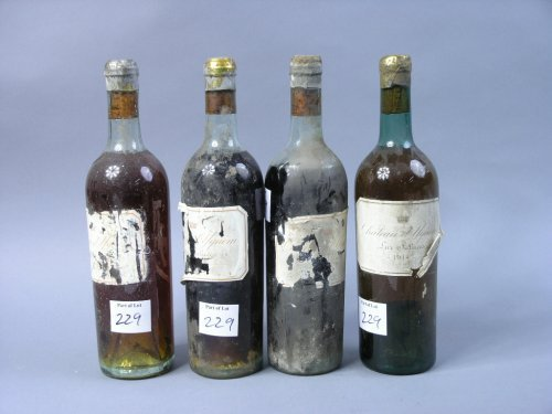 229: A bottle of Chateau Yquern 1914 & 3 other bottles