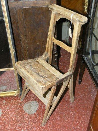 1070: A Victorian oak metamorphic chair,