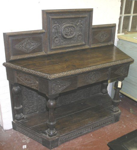 1073: A Victorian carved oak hall table, 4ft 8ins