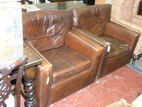 1086: A pair of brown leather tub chairs,