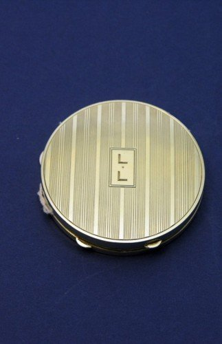 1639: A Cartier 14k gold circular box, 2.25ins