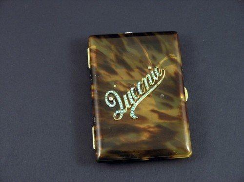1640: George V 18k gold and tortoiseshell cigarette cas