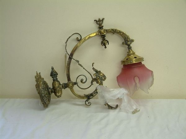 218F: A rococo style brass wall lamp, 18in.