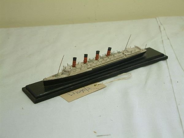 223F: A carved and painted wood waterline model of an o