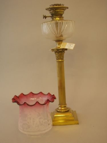 9E: A Victorian oil lamp with later cranberry glass sha